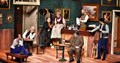 cast sitting on stage at the Lapin Agile